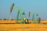 Oil pumpjack (pump jack) in farmer's field<br /> Carlisle<br /> Saskacthewan <br /> Canada