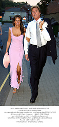MISS MARINA HANBURY and MR ROBIN HURLSTONE former partner of Joan Collins, at a wedding in Suffolk in London on 20th September 2003.PMT 335