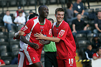 Photo: Pete Lorence.<br />Notts County v Swindon Town. Coca Cola League 2. 23/09/2006.<br />Fola Onibuje is congratulated by his team mates after scoring the opening goal of the match.