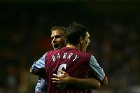 Photo: Andrew Unwin.<br />Sunderland v Aston Villa. The Barclays Premiership.<br />19/11/2005.<br />Aston Villa's Gareth Barry (#6) celebrates with his captain, Olof Mellberg.
