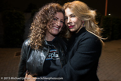 """EICMA's Ela Dutch with photographer Monica Silva Portrait, at the """"Live the Night Faster"""" party hosted by Yamaha at the Officine del Volo during EICMA, the largest international motorcycle exhibition in the world. Milan, Italy. November 17, 2015.  Photography ©2015 Michael Lichter."""