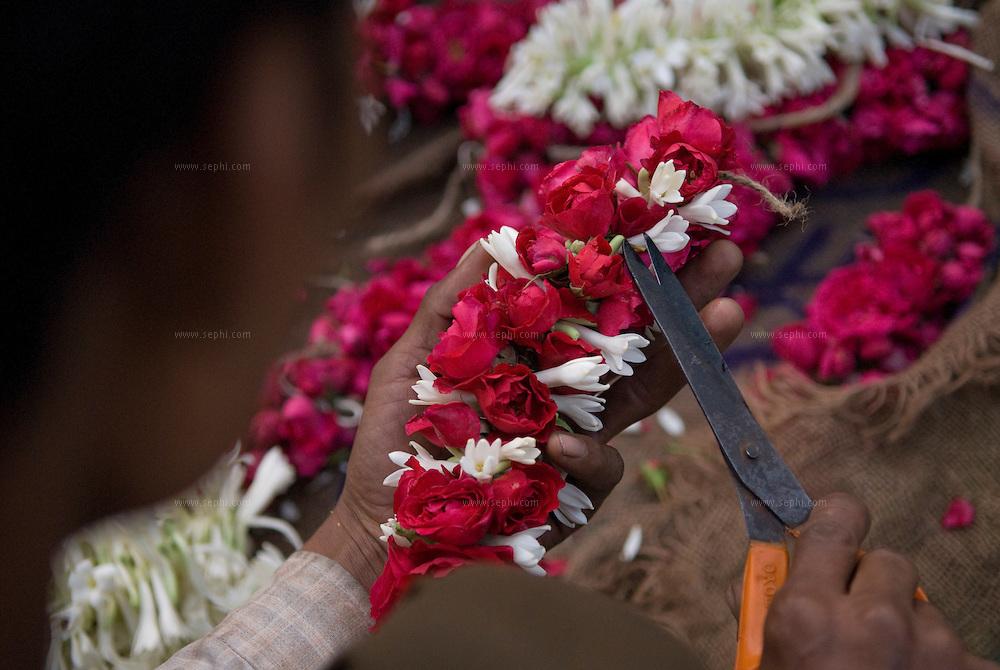 flowers at the morning flower market on Baba Kharak Singh Marg near hanuman mandir in New Delhi