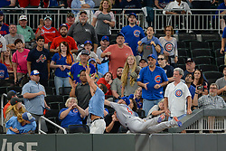 May 15, 2018 - Atlanta, GA, U.S. - ATLANTA, GA Ð MAY 15:  Cubs outfielder Ian Happ (8) dives into the crowd attempting to catch a foul ball during the game between Atlanta and Chicago on May 15th, 2018 at SunTrust Park in Atlanta, GA. The Chicago Cubs beat the Atlanta Braves by a score of 3 Ð 2.  (Photo by Rich von Biberstein/Icon Sportswire) (Credit Image: © Rich Von Biberstein/Icon SMI via ZUMA Press)