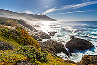 The waves of the Pacific Ocean crash into the rocky shores of Big Sur in California.