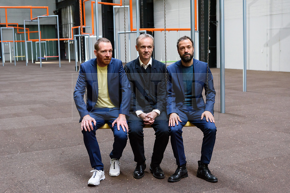 © Licensed to London News Pictures. 02/10/2017. London, UK. JAKOB FENGER, RASMUS NIELSEN and BJORNSTJERNE CHRISTIANSEN of the Copenhagen artist group SUPERFLEX transforms the Tate Modern Turbine Hall with their creation  'One Two Three Swing!' for the third Hyundai Commission. Based in Copenhagen SUPERFLEX was founded in 1993 by Danish artists and Bjørnstjerne Christiansen, Jakob Fenger and Rasmus Nielsen. They have gained international recognition for their projects and solo exhibitions around the world. Photo credit: Ray Tang/LNP