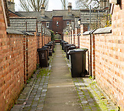 Rubbish refuse bins in back alley of terraced houses in Railway Village, Swindon, Wiltshire, England, UK