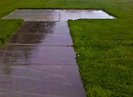 wet sidewalk to helicopter landing pad