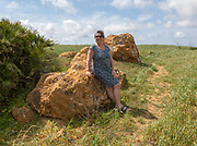 Woman at neolithic prehistoric megalith site near Hortas do Tabual, Algarve, Portugal, southern Europe