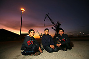 Three young Afghan boys wait in Calais docks, France, September 24, 2009. The young migrants had been moved by French Police the previous day from their makeshift camp in the outskirts of Calais known as 'The Jungle'. For many 'The Jungle' was their last stop before attempting to illeagally cross the English Channel to the UK.    Picture by Paul Hackett/ Corbis