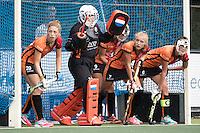 UTRECHT - HOCKEY -  verdediging OR met oa Laura Nunnink (Oranje-Rood) , keeper Larissa Meijer (Oranje-Rood) , Kyra Fortuin (Oranje-Rood) , Daphne van der Velden (Oranje-Rood)   tijdens  de hoofdklasse hockeywedstrijd dames Kampong-Oranje-Rood (0-5) .  COPYRIGHT KOEN SUYK