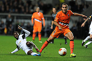 Nathan Dyer of Swansea city is challenged by Oriol Romeu of Valencia (r).UEFA Europa league match, Swansea city v Valencia at the Liberty Stadium in Swansea on Thursday 28th November 2013. pic by Andrew Orchard, Andrew Orchard sports photography,