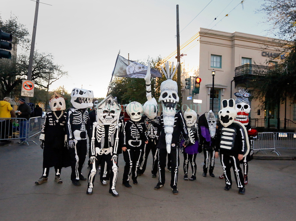 09 February 2016. New Orleans, Louisiana.<br /> Mardi Gras Day. Walking with Skeletons. The Skeleton Krewe meet before sunrise and walk 5 miles from Uptown, making their way along St Charles Avenue and into the French Quarter where they celebrate Mardi Gras Day.<br /> Photo©; Charlie Varley/varleypix.com