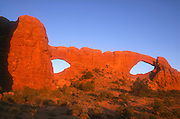 The North and South Windows in Arches National Park near Moab, Utah, are natural windows that eroded from the same Estrada sandstone fin.