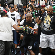 LAS VEGAS, NV - APRIL 14: WBC/WBA welterweight champion Floyd Mayweather Jr. (R) works out with his uncle Roger Mayweather at the Mayweather Boxing Club on April 14, 2015 in Las Vegas, Nevada. Mayweather Jr. will face WBO welterweight champion Manny Pacquiao in a unification bout on May 2, 2015 in Las Vegas.  (Photo by Alex Menendez/Getty Images) *** Local Caption *** Floyd Mayweather Jr., Roger Mayweather