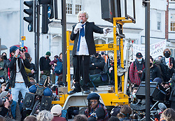 """© Licensed to London News Pictures;03/04/2021; Bristol, UK. A performer acting as Prime Minister Boris Johnson entertains the crowd at a fifth """"Kill the Bill"""" protest in a fortnight taking place in Bristol against the Police, Crime, Sentencing and Courts Bill during the Covid-19 coronavirus pandemic in England. The Bill proposes new restrictions on protests. Some previous Kill the Bill protests in Bristol had violence. Photo credit: Simon Chapman/LNP."""