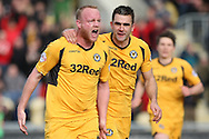 Newport's Lee Minshull (left) celebrates after he scores his side's first goal. Skybet football league 2 match, Newport county v Scunthorpe Utd at Rodney Parade in Newport, South Wales on Saturday 1st March 2014.<br /> pic by Mark Hawkins, Andrew Orchard sports photography.