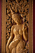 Gilded door carving at the Wat Xieng Thong  Buddhist temple complex, Luang Prabang, Laos