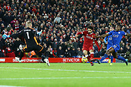 Mohamed Salah of Liverpool shoots past Leicester goalkeeper Kasper Schmeichel and scores his teams 2nd goal to make it 2-1 . Premier League match, Liverpool v Leicester City at the Anfield stadium in Liverpool, Merseyside on Saturday 30th December 2017.<br /> pic by Chris Stading, Andrew Orchard sports photography.