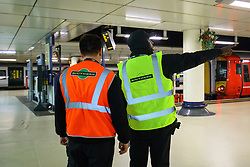 © Licensed to London News Pictures. 06/12/2016. London, UK. Southern Rail workers talk at Victoria Station in London on 6 December 2016, as hundreds of thousands of rail passengers face a days of travel chaos because of a 72-hour strike in an escalating dispute over the role of conductors between Southern Rail and the RMT Union. Photo credit: Tolga Akmen/LNP