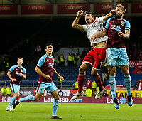 Burnley's Charlie Taylor gets an elbow in the face from Olympiakos' Lazaros Christodoulopoulos<br /> <br /> Photographer Alex Dodd/CameraSport<br /> <br /> UEFA Europa League - UEFA Europa League Qualifying Second Leg 2 - Burnley v Olympiakos - Thursday August 30th 2018 - Turf Moor - Burnley<br />  <br /> World Copyright © 2018 CameraSport. All rights reserved. 43 Linden Ave. Countesthorpe. Leicester. England. LE8 5PG - Tel: +44 (0) 116 277 4147 - admin@camerasport.com - www.camerasport.com