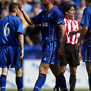 Leicester City's Matt Elliott gestures to Athletic Bilboa's no. 9 after being elbowed by the Spaniard which resulted in him being sent off