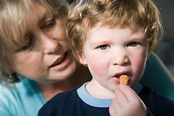 Woman talking to little boy,