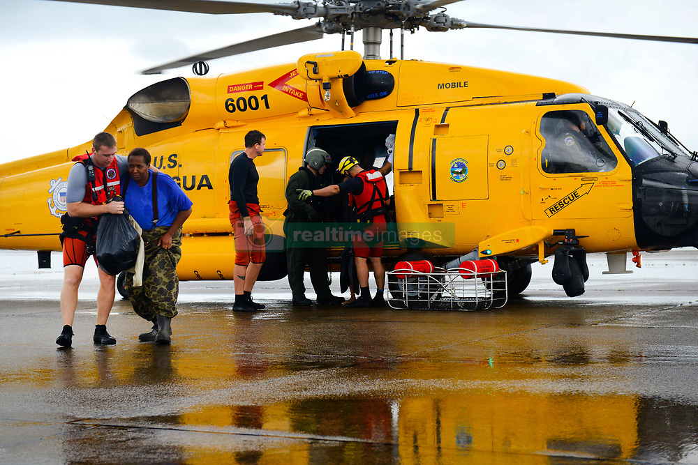 Coast Guard Air Station Houston responds to search and rescue requests after Hurricane Harvey in Houston, Texas, Aug. 27, 2017. The Coast Guard is working closely with all local and state emergency operation centers and has established incident command posts to manage Coast Guard storm operations.<br /> <br /> U.S. Coast Guard photo by Petty Officer 3rd Class Johanna Strickland.
