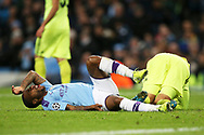 Manchester City midfielder Raheem Sterling (7) lies in pain during the Champions League match between Manchester City and Dinamo Zagreb at the Etihad Stadium, Manchester, England on 1 October 2019.
