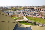A view of a car park and train line from the roof of The Hive in Worcester, UK.