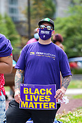 Wilkes-Barre, PA (July 11, 2020) -- A man in an SEIU Healthcare shirt listens to a speaker at the Black Lives Matter NEPA United Movement event at Wilkes-Barre Public Square.