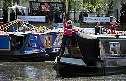 © Licensed to London News Pictures. 04/05/2019. London, UK. A boat takes part in the pageant at the Canalway Cavalcade festival in Little Venice, West London on Saturday, May 4th 2019. Inland Waterways Association's annual gathering of canal boats brings around 130 decorated boats together in Little Venice's canals on May bank holiday weekend. Photo credit: Ben Cawthra/LNP
