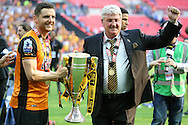 Steve Bruce, the Hull City manager and Alex Bruce of Hull City pose with the Sky Bet Championship Playoff Trophy.Skybet football league Championship play off final match, Hull city v Sheffield Wednesday at Wembley Stadium in London on Saturday 28th May 2016.<br /> pic by John Patrick Fletcher, Andrew Orchard sports photography.