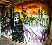 Graffiti of a sad man in a war zone theme