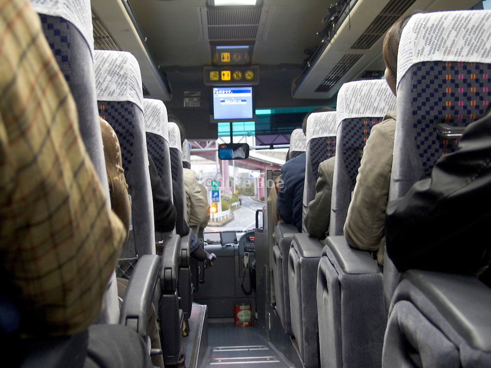 passengers inside a bus on there way from Narita International Airport to Tokyo