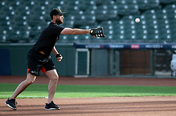 Oct 7, 2021; San Francisco, CA, USA; San Francisco Giants infielder Brandon Belt (9), who is out with a thumb injury, wears a brace on his left hand while fielding grounders during NLDS workouts. Mandatory Credit: D. Ross Cameron-USA TODAY Sports