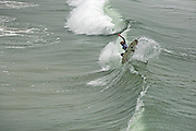 Surfing Waves in Huntington Beach California