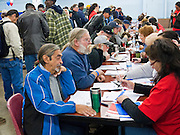 04 FEBRUARY 2011 - PHOENIX, AZ: Homeless and at risk veterans register for services at the Arizona StandDown in Phoenix Friday. The Arizona StandDown is an annual three day event that brings together the Valley's homeless and at-risk military veterans, connecting them with services ranging from: VA HealthCare, mental health services, clothing, meals, emergency shelter, transitional and permanent housing, ID/ drivers license's, court services and Legal Aide, showers, haircuts and myriad other services and resources.  Arizona StandDown is held annually at the Veterans Memorial Coliseum at the Arizona State Fairgrounds in Phoenix on Super Bowl weekend.    Photo by Jack Kurtz