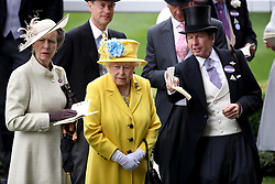 Queen Elizabeth II, the Princess Royal and trainer John Warren during day one of Royal Ascot at Ascot Racecourse.