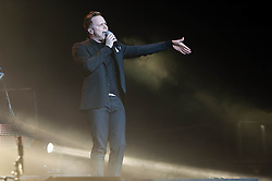 """© Licensed to London News Pictures. 29/03/2013. London, UK.   Olly Murs performing live at O2 Arena. Oliver Stanley """"Olly"""" Murs is an English singer-songwriter, musician and television presenter. Murs rose to fame after finishing as the runner-up in the sixth series of The X Factor in 2009. Photo credit : Richard Isaac/LNP"""