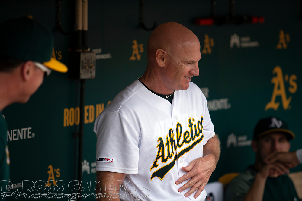 Oakland Athletics third base coach Matt Williams (4) in the dugout before a baseball game against the Texas Rangers, Sunday, Sept. 22, 2019, in Oakland, Calif. (AP Photo/D. Ross Cameron)