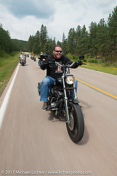 Roadside Marty on the Aidan's Ride to raise money for the Aiden Jack Seeger nonprofit foundation to help raise awareness and find a cure for ALD (Adrenoleukodystrophy) during the annual Sturgis Black Hills Motorcycle Rally. Riding between Nemo and Rapid City, SD, USA. Tuesday August 8, 2017. Photography ©2017 Michael Lichter.