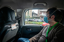 Milan - Coronavirus emergency. USCA Special Continuity Care Units. Dr. Lops visits a quarantined patient at home for being in contact with a positive. The doctor takes a taxi to go to the patients