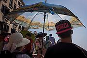 Tourist umbrella in Piazza San Marco, Venice, Italy