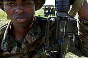 Recruit Paterson, from Georgia, waits for his turn a the rifle range, in the background three recruits guard the ammunition.  Marine Corps Recruit Depot at Parris Island in South Carolina is where all male recruits living east of the Mississippi River and all female recruits from all over the US receive their arduous twelve week training in their quest to become marines. Even though there are two current active wars and a weak economy, recruitment has not been effected.  Actually, recruiting numbers have increased, with more young men and women looking toward the military for answers.