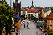 Mostly Czech visitors are moving across an almost empty Charles Bridge seen from the Lesser Town (Mala Strana) Bridge Towers towards the city center. The Czech government lowered the security measures and as of Monday 25 May 2020, wearing of protective masks will be mandatory only in the interiors of buildings other than the place of residence and in public transport.