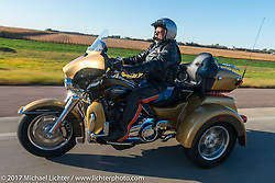 Riding a Harley-Davidson Tri-Glide in the USS South Dakota submarine flag relay across South Dakota. Groton, SD. USA. Sunday October 8, 2017. Photography ©2017 Michael Lichter.