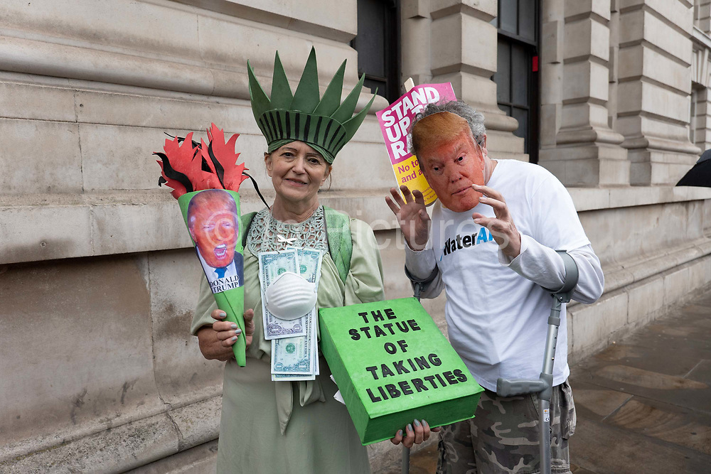 A lady dressed as the Statue of Liberty during a demonstration against U.S. President Donald Trumps state visit to the U.K on the 4th June 2019 in London in the United Kingdom. Day two of President Trumps three-day state visit, which includes lunch with the Queen, a State Banquet at Buckingham Palace as well as business meetings with the Prime Minister and the Duke of York, before travelling to Portsmouth to mark the 75th anniversary of the D-Day landings.