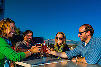 """Friends having drinks on the rooftop patio of """"Bailey's on the Beach"""", Nob Hill, Albuquerque, New Mexico USA"""