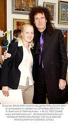 Musician BRIAN MAY and his daughter MISS LOUISA MAY at a reception in London on 22nd May 2002.PAH 16