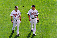 Minnesota Twins Scott Diamond #58 and Rick Anderson #40 walk toward the bullpen before a game against the Baltimore Orioles at Target Field in Minneapolis, Minnesota on July 16, 2012.  The Twins defeated the Orioles 19 to 7 setting a Target Field record for runs scored by the Twins.  © 2012 Ben Krause